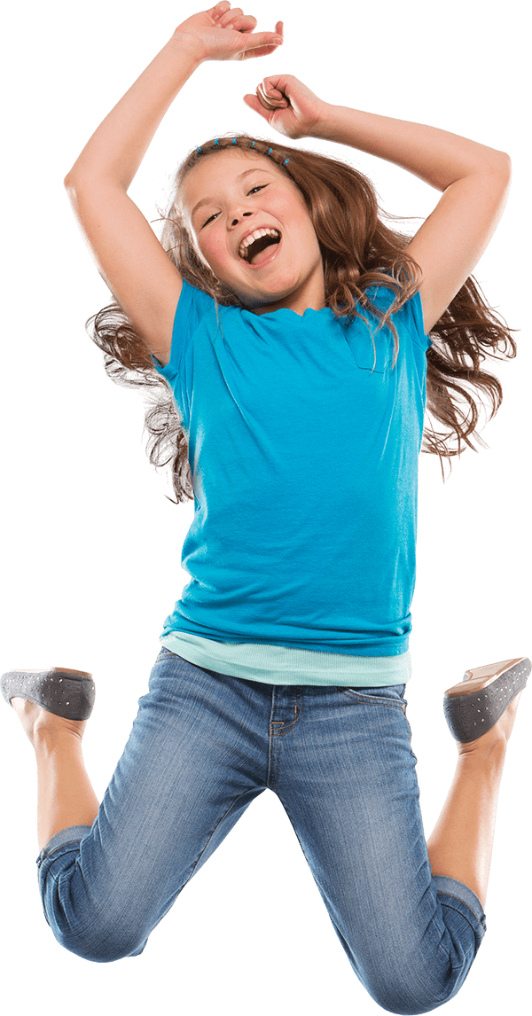 Little girl happy jumping in air celebrating pediatric dentist