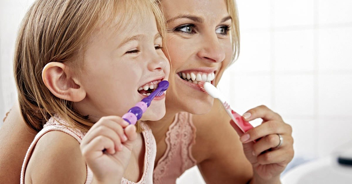 Mother And Daughter Brushing Teeth Together ICTeeth Pediatric Dentistry